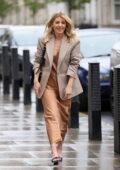 Mollie King looks stylish wearing a bronze shiny dress at BBC Radio 1 in London, UK