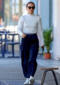 Natalie Portman wears a white sweater and blue corduroy pants for a lunch outing with her mother in Sydney, Australia