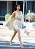Nicole Williams stops traffic during a street style fashion photoshoot in Beverly Hills, California