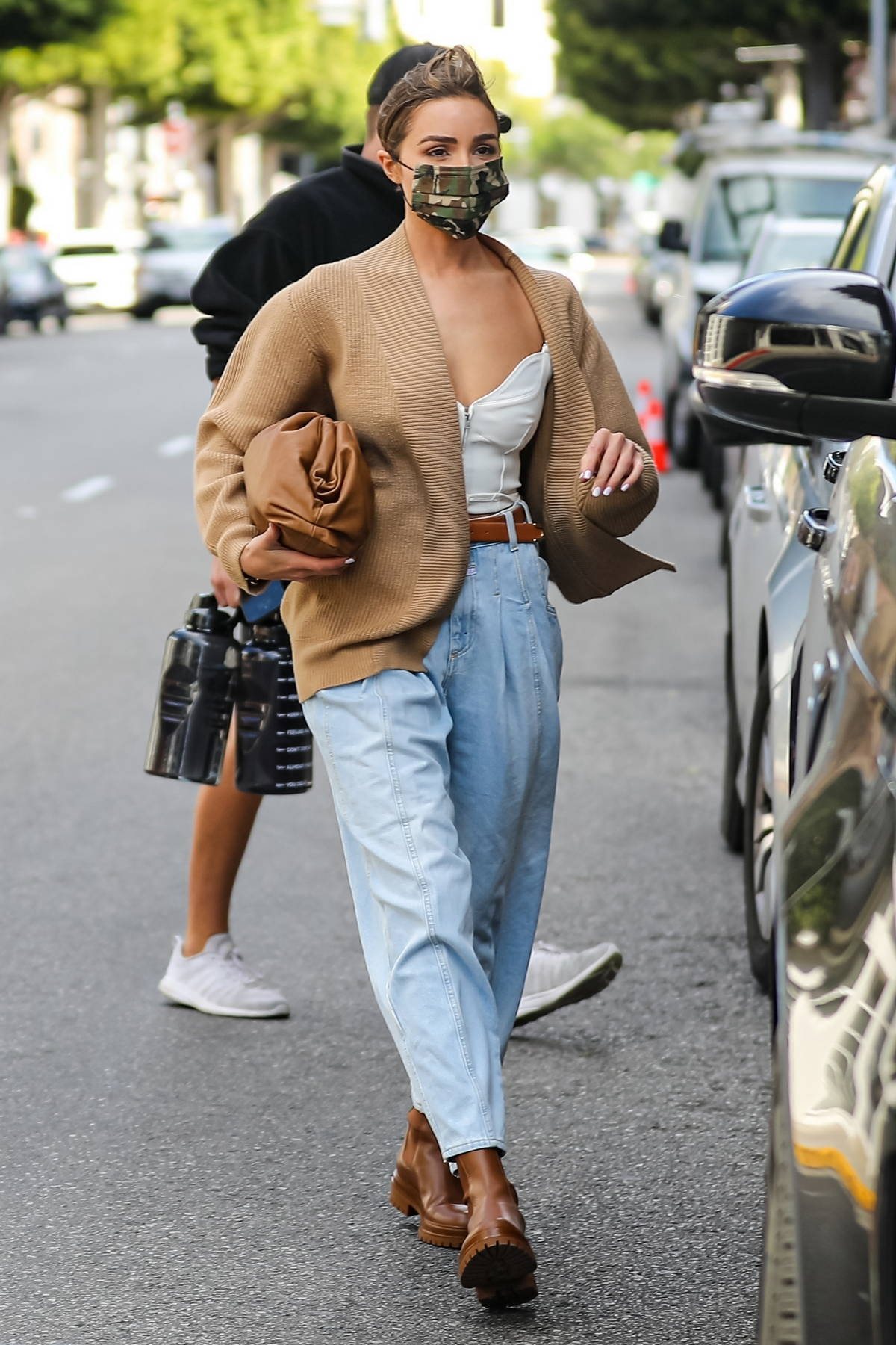 Olivia Culpo looks chic in a brown cardigan while visiting Epione skin care clinic in Beverly Hills, California