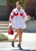 Olivia Culpo looks super chic in a white Valentino shirt dress with stylish heels while making a coffee run in Los Angeles