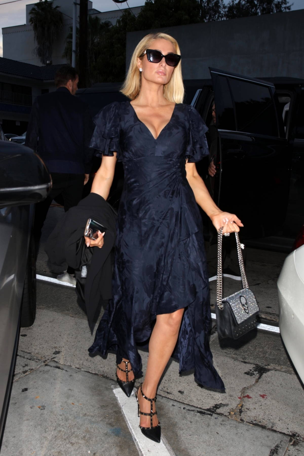 Paris Hilton wears a navy blue dress for a family dinner at Craig's Restaurant in West Hollywood, California