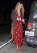 Paris Jackson arrives at Catch wearing a red dress and a Louis Vuitton bag in West Hollywood, California