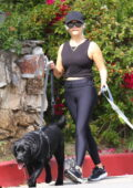 Reese Witherspoon keeps it sporty in a black tank top and leggings while walking her dogs in Brentwood, California