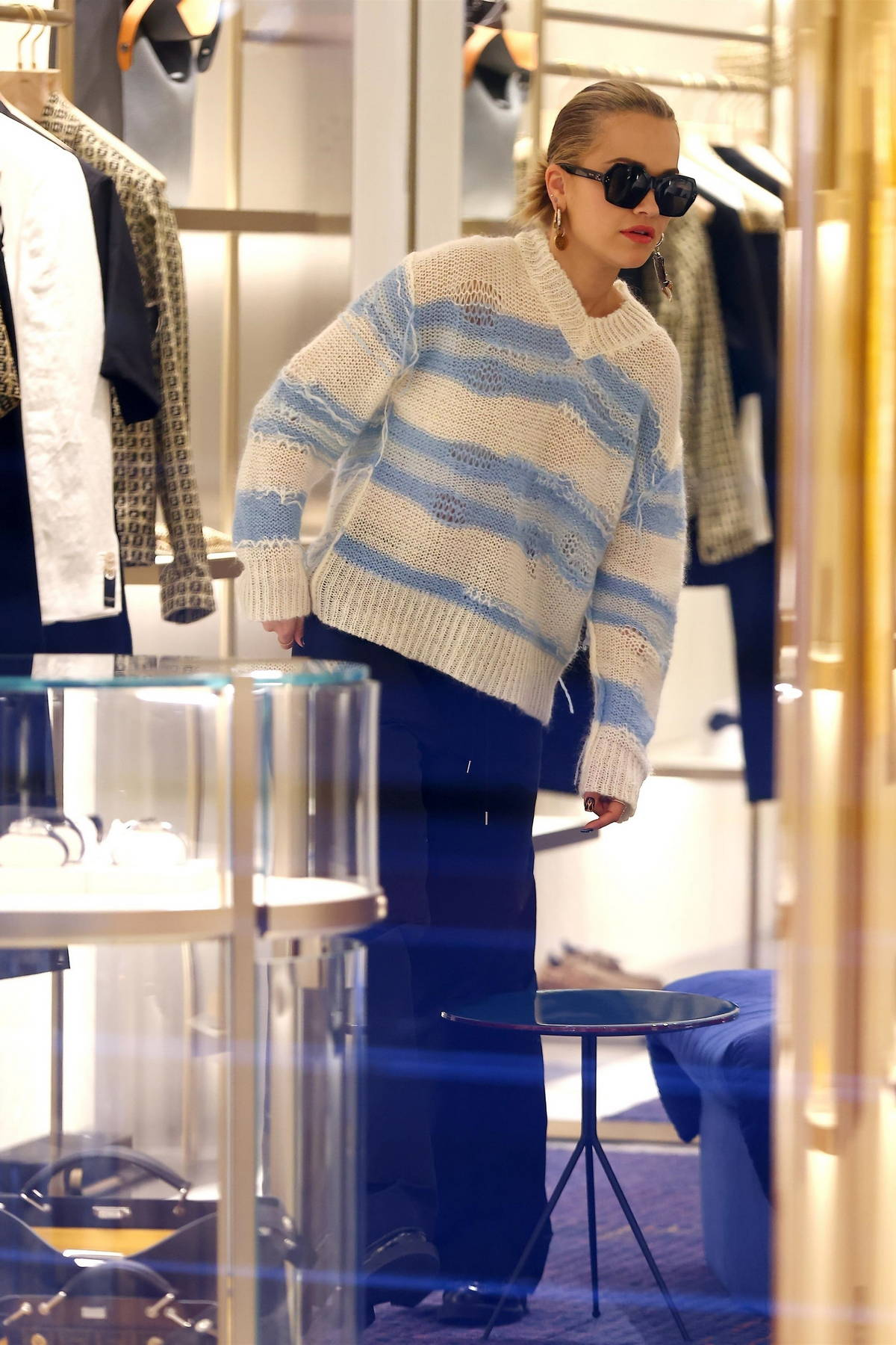 Rita Ora looks cool in a distressed sweater while shopping at a Fendi Store with Elsa Pataky in Sydney, Australia