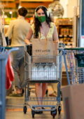 Rumer Willis enjoys music on her Apple Airpod Max while shopping groceries at Erewhon in Los Angeles