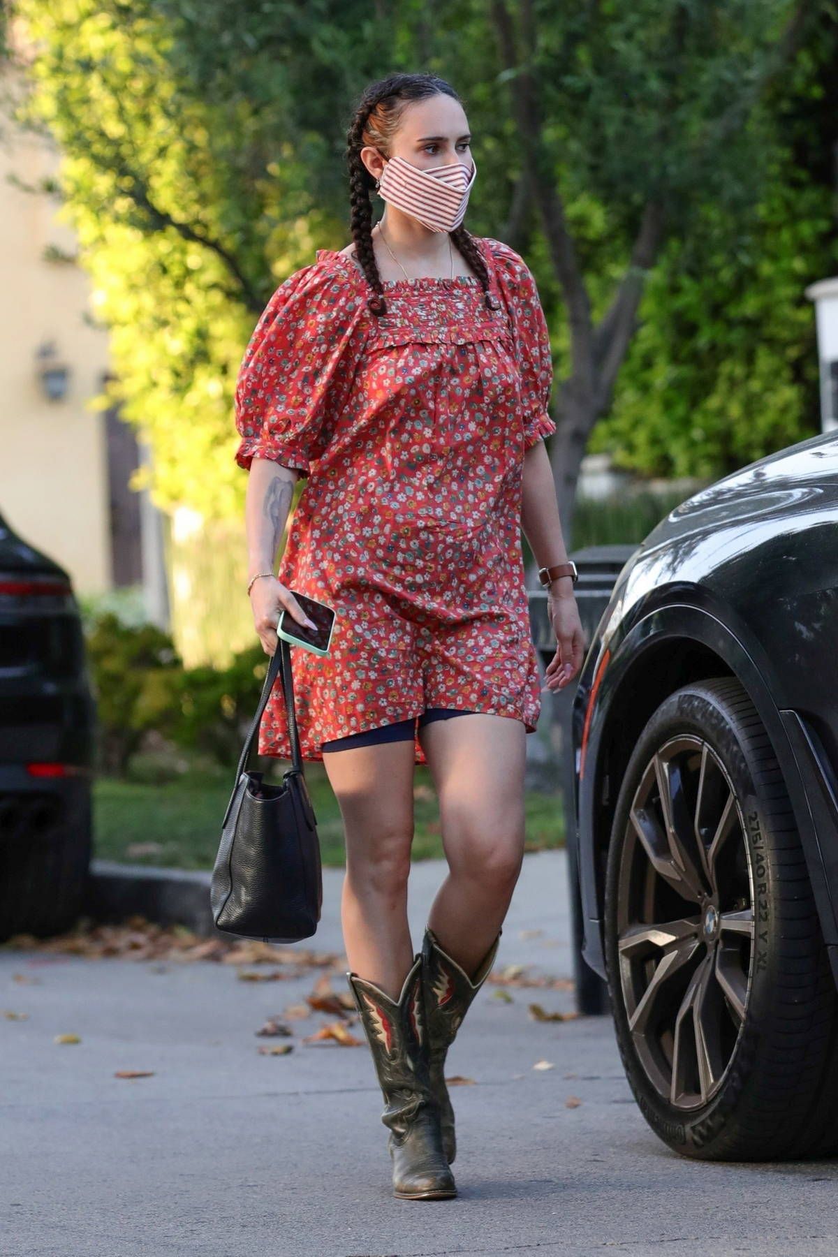 Rumer Willis leaves her late afternoon Pilates class in a floral print dress and cowboy boots in West Hollywood, California