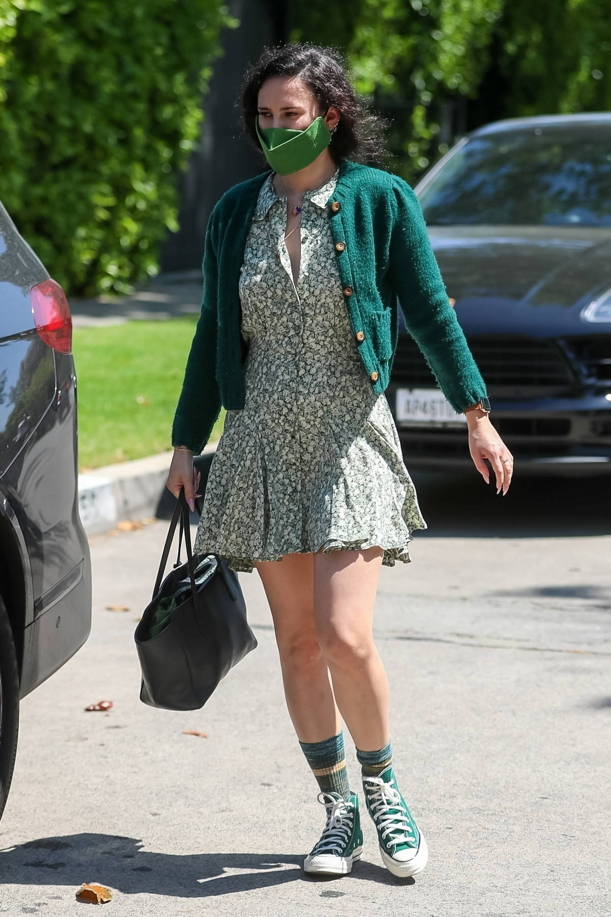 Rumer Willis wears a green cardigan over a floral print dress as she leaves her Pilates class in West Hollywood, California