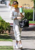 Rumer Willis wears a white floral print dress as she arrives for her Pilates class in West Hollywood, California