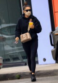 Shay Mitchell sports all-black hoodie and leggings while making a juice run in West Hollywood, California