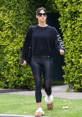 Sofia Boutella dons black sweatshirt and leggings with UGG slippers for her Pilates class in West Hollywood, California