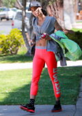 Sofia Boutella flashes her abs in bright pink Nike leggings as she attends a Pilates class in West Hollywood, California