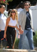 Sofia Richie and her boyfriend Elliot Grainge hold hands after a lunch date at Taverna Tony in Malibu, California