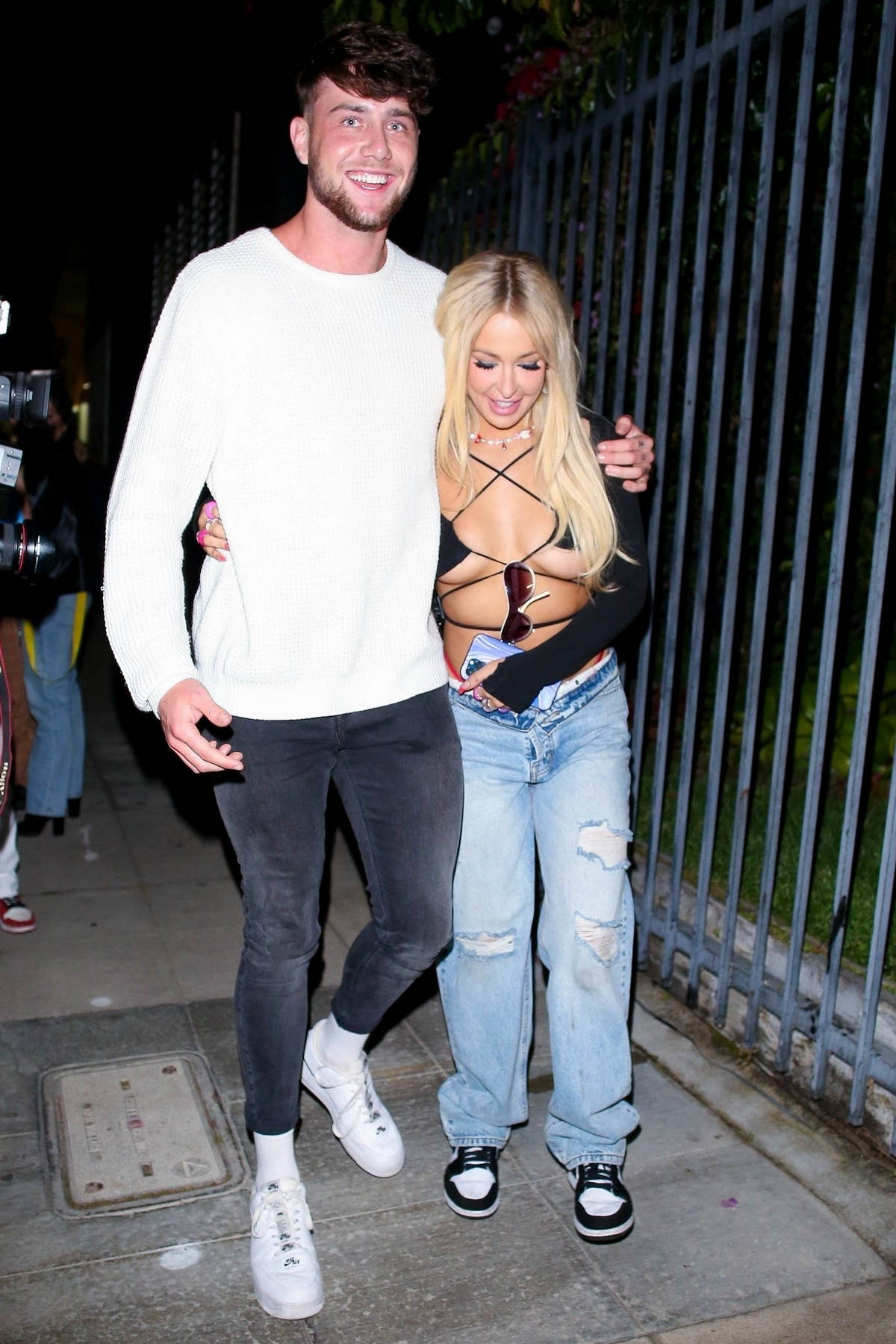 Tana Mongeau and Harry Jowsey get cozy while attending a private party in Hollywood, California