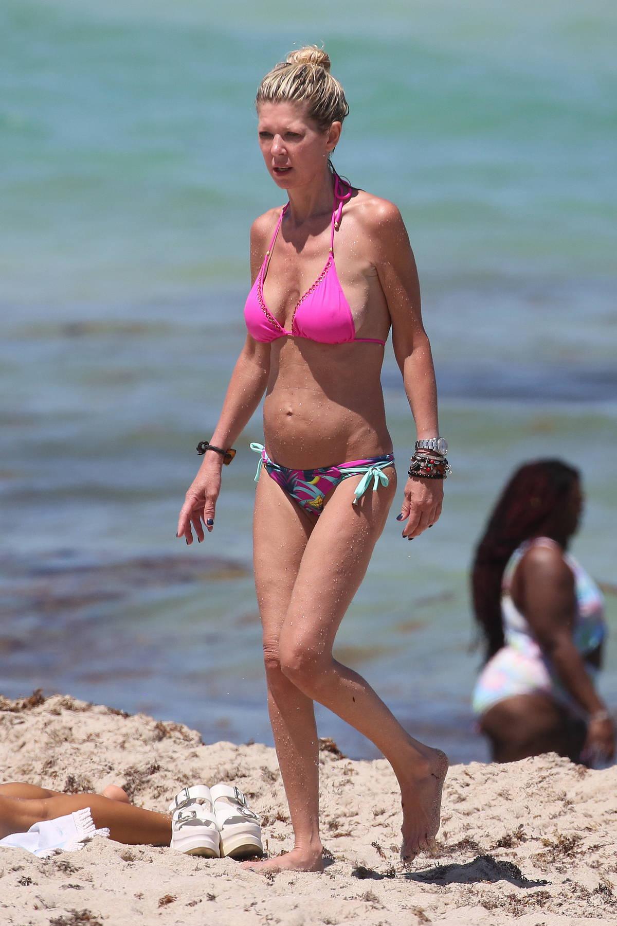 Tara Reid wears a pink bikini as she hits the beach with friends in Miami, Florida
