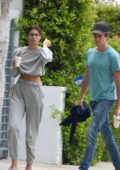 Taylor Hill dresses down in grey sweatsuit while making a coffee run with boyfriend Daniel Fryer in Los Angeles