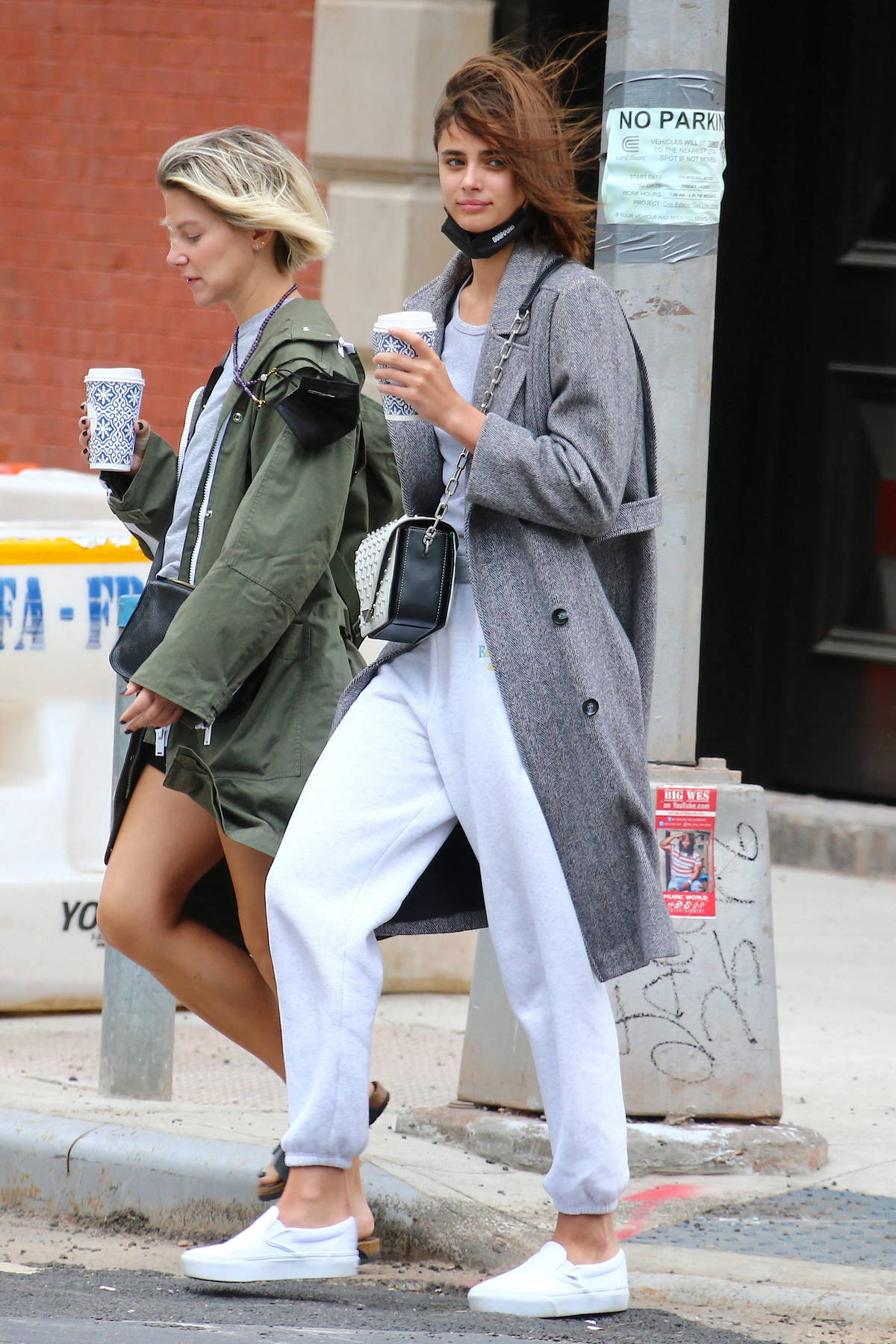Taylor Hill looks casually chic as she enjoys a stroll and coffee with a friend in Tribeca, New York