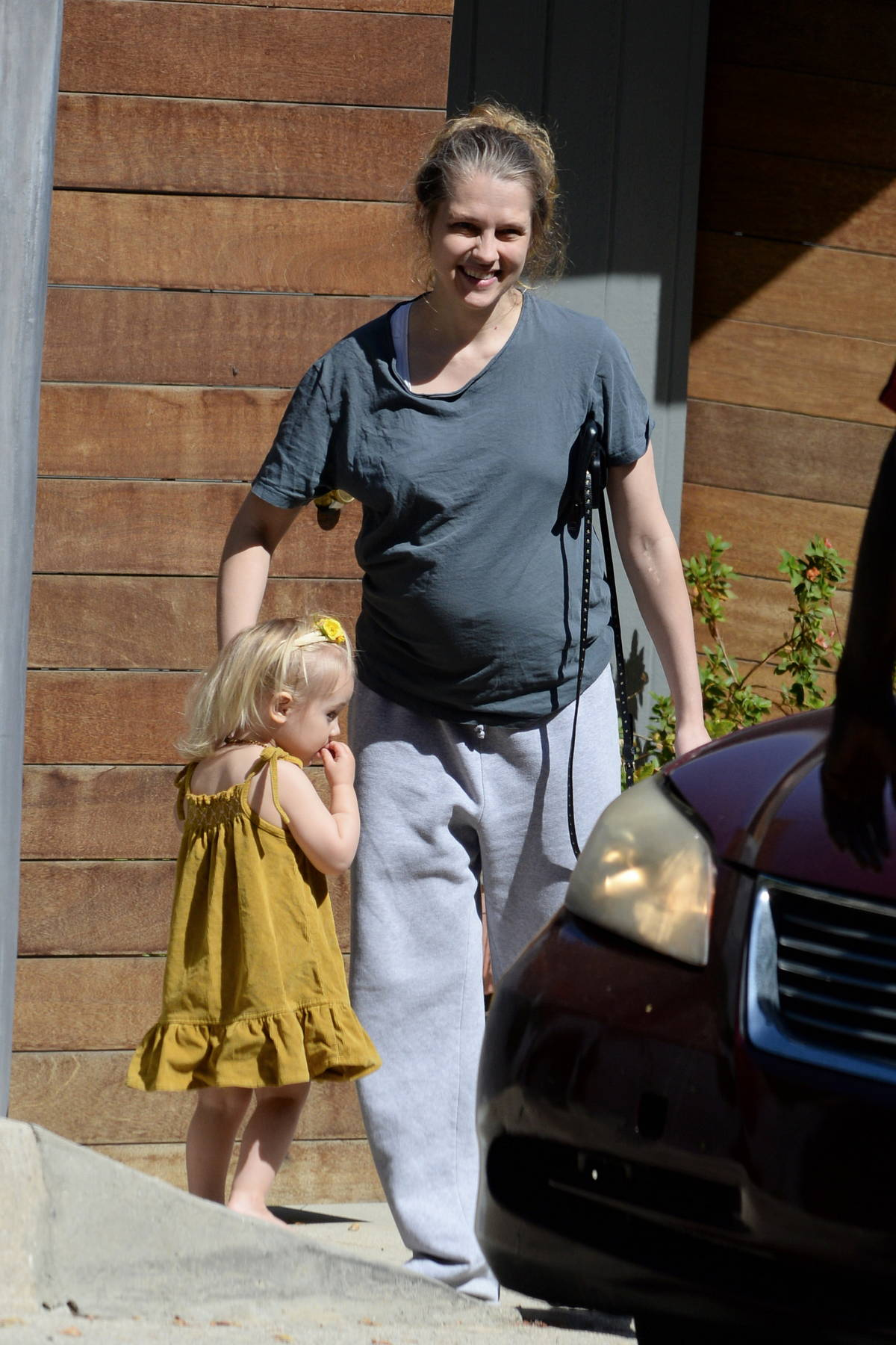 Teresa Palmer shows off her growing baby bump while stepping out in Los Angeles