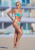 Tina Louise shows off her tattoos in a turquoise bikini while enjoying a beach day in Venice, California