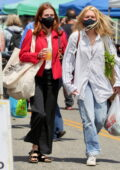 Zoey Deutch goes shopping for fresh produce at the farmers market in Los Angeles