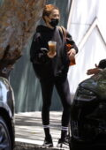 Zoey Deutch grabs an iced-coffee with a friend after wrapping up a workout session in West Hollywood, California