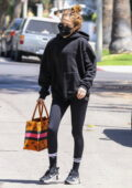 Zoey Deutch seen leaving a Pilates class wearing a black hoodie and leggings in West Hollywood, California