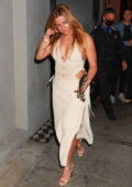 Addison Rae looks stunning in a plunging knitted dress during a late dinner at Craig's in West Hollywood, California