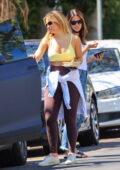Addison Rae sports a yellow sports bra and brown leggings for a workout session in West Hollywood, California