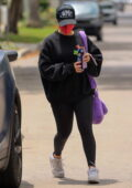 Addison Rae sports all-black sweatshirt and leggings for a Pilates session in West Hollywood, California