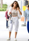 Alessandra Ambrosio dons all-white Alo sweatsuit for a Pilates class in Los Angeles