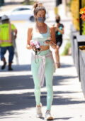 Alessandra Ambrosio flashes her taut abs while leaving after a Pilates class in West Hollywood, California