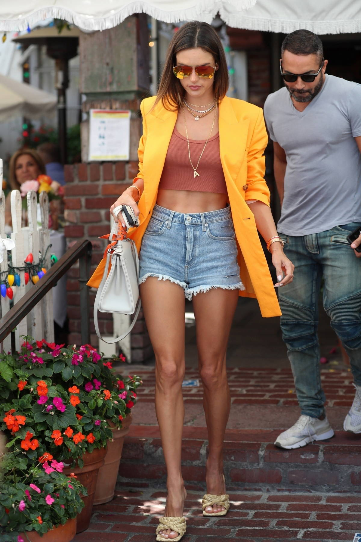 Alessandra Ambrosio looks ravishing in orange blazer and denim shorts while out for lunch with friends in Beverly Hills, California