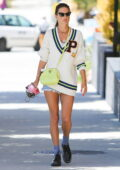 Alessandra Ambrosio puts on a leggy display in denim shorts with a varsity sweater while out running errands in Los Angeles