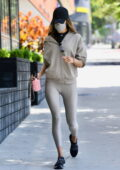 Alessandra Ambrosio sports a black crop top, a grey jacket, and leggings for a Pilates class in Los Angeles