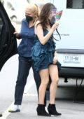 Anne Hathaway arrives on the set of 'WeCrashed' wearing a blue mini dress in China Town, New York