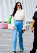 Anne Hathaway looks stylish in a sheer lace turtleneck and flared denim on the set of the 'WeCrashed' in New York City