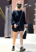 Ashley Benson dons an oversized black sweatshirt while making a quick trip to Rite Aid in West Hollywood, California