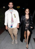 Becky G and Sebastian Lletget hold hands as they step out for dinner at Delilah in West Hollywood, California