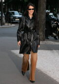Bella Hadid rocks a leather trench coat and tan denim pants while stepping out in Paris, France