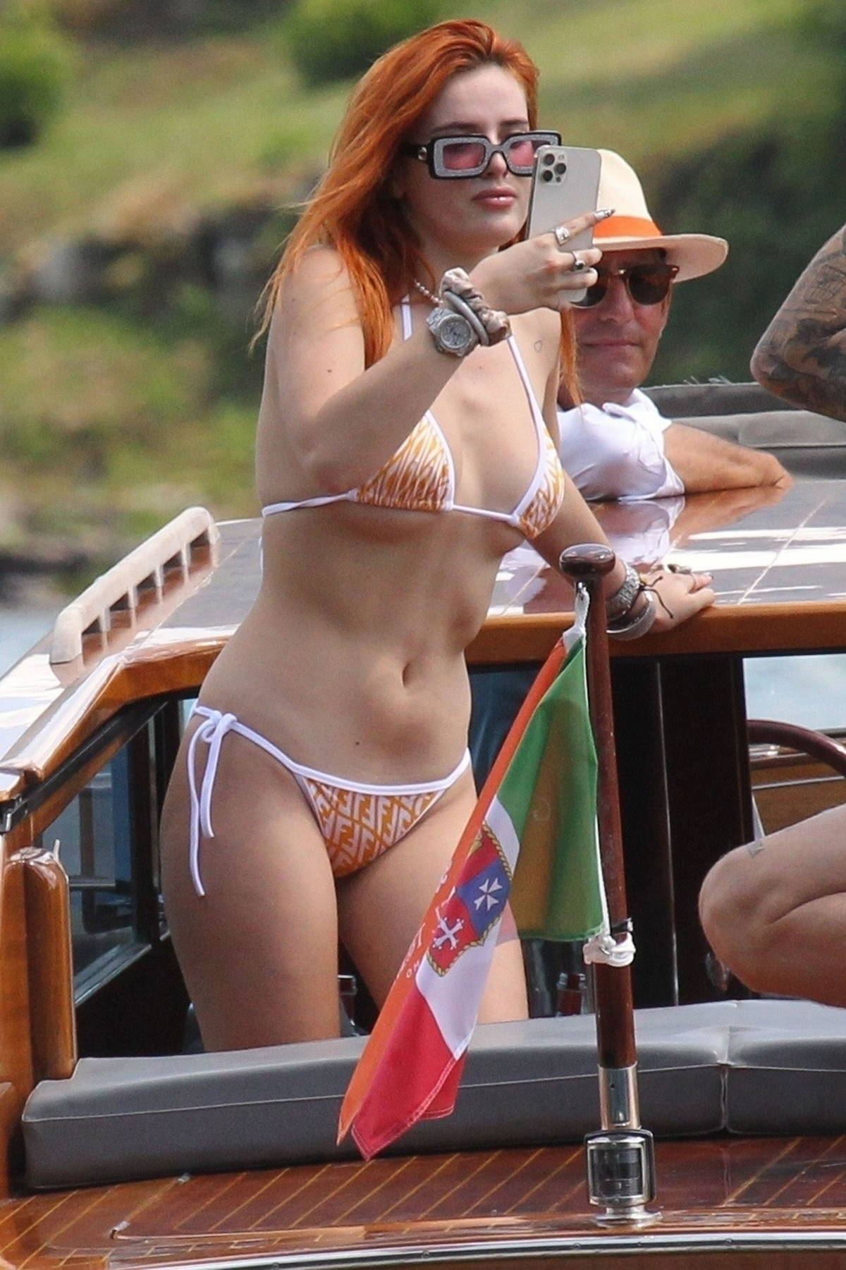 Bella Thorne shows off her curves in a Fendi bikini while enjoying a day on a boat with Benjamin Mascolo, Lake Como, Italy