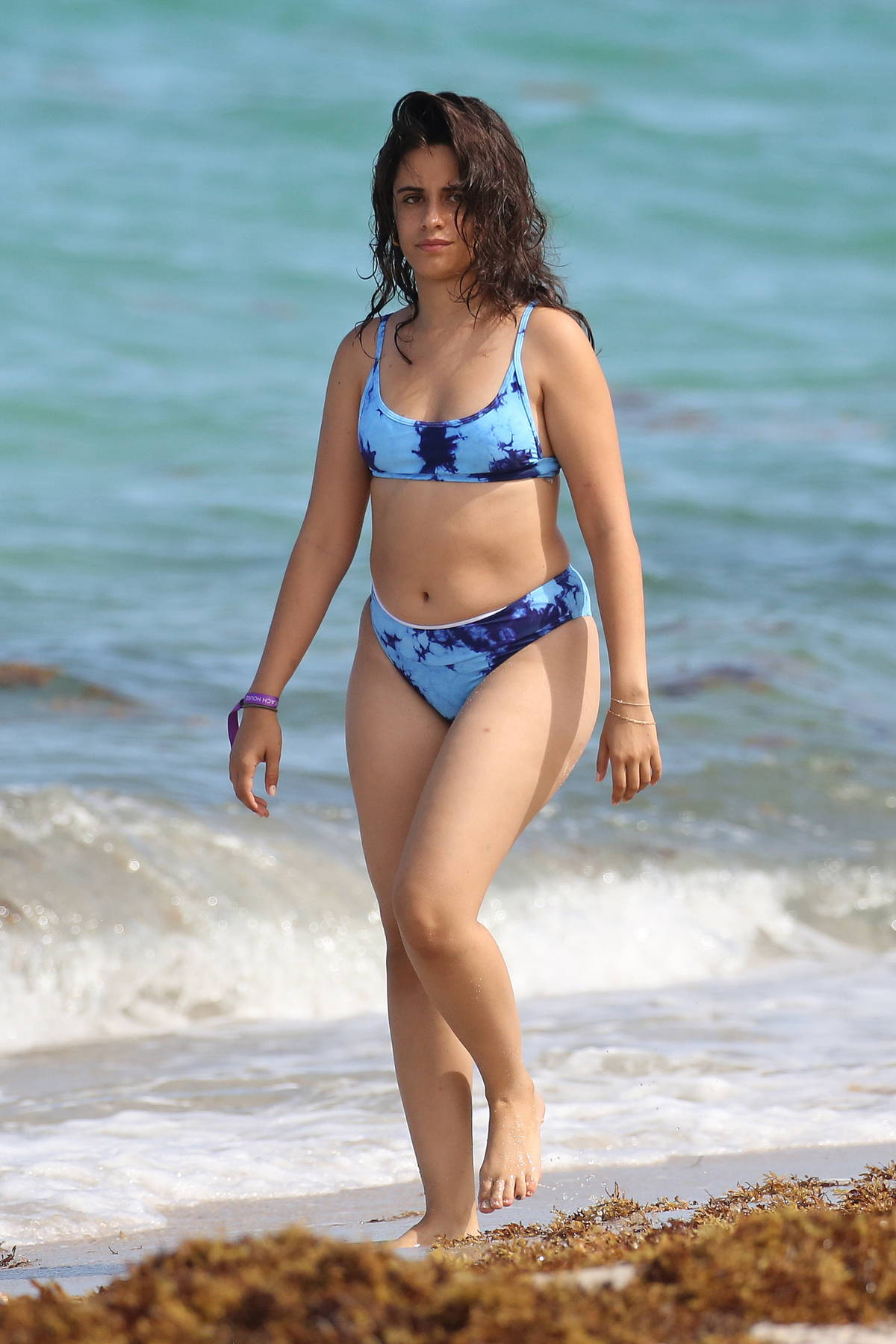 Camila Cabello shows off her curves in a blue bikini as she enjoys a beach day with Shawn Mendes in Miami, Florida