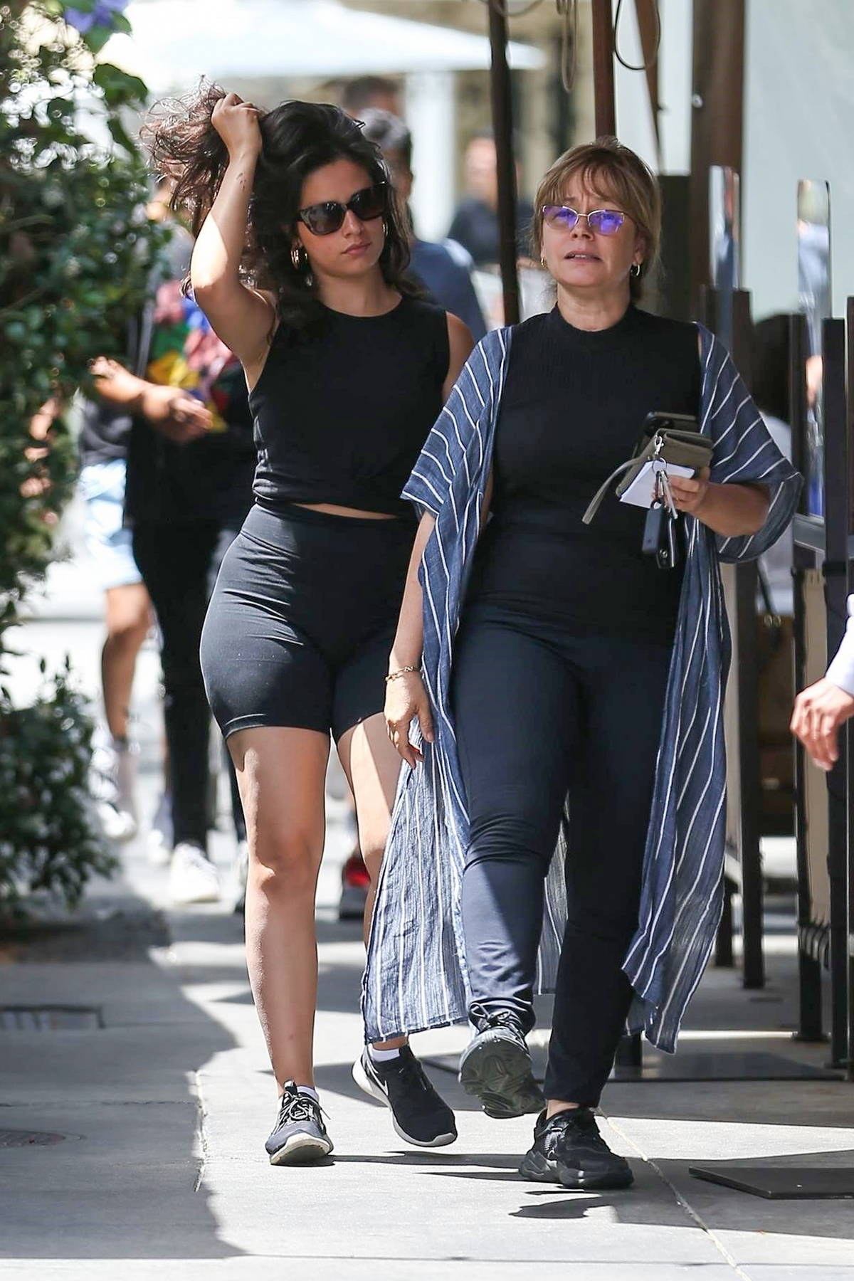 Camila Cabello wears a black crop top and shorts as she leaves Il Pastaio after lunch in Beverly Hills, California
