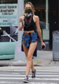 Candice Swanepoel shows off her super-model frame in a crop top and patterned short shorts as she steps out in New York City