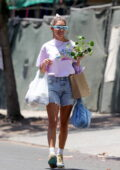 Chantel Jeffries is all smiles as she picks up a new plant while out shopping at the Farmers Market in West Hollywood, California