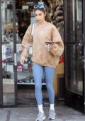 Chantel Jeffries runs a few errands wearing a light brown sweatshirt and blue leggings in Los Angeles