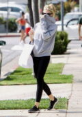 Charlotte McKinney covers her face while on a shopping trip in West Hollywood, California