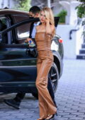 Charlotte McKinney looks amazing in a brown leather outfit heading to dinner at Sunset Towers with friends in Los Angeles