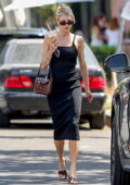 Charlotte McKinney looks smashing in a black bodycon dress while out for an iced coffee in Los Angeles