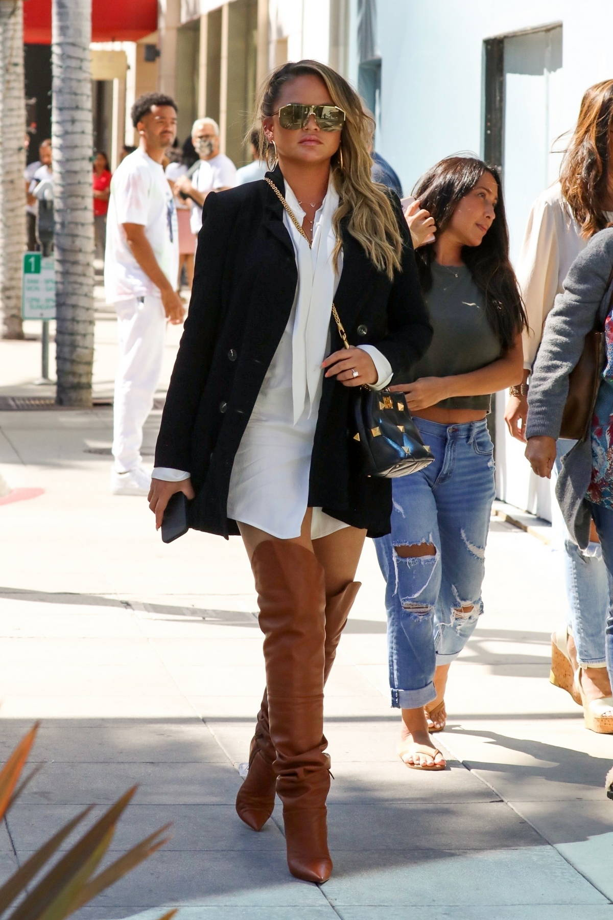 Chrissy Teigen rocks a pair of thigh-high boots while out enjoying some ice cream after lunch in Studio City, California