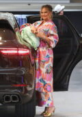 Chrissy Teigen wears a colorful floral print ensemble while out for a family lunch at Soho House in West Hollywood, California